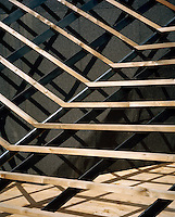 Detail of the latticework of larch wood which Ulla Hell has used to clad the exterior of her modern chalet