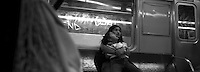 Young woman and little girl. Subway series shot in New York between the years 1998 and 2001