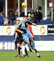 Luke O'Nien of Wycombe Wanders heads the ball back towards goal during the Sky Bet League 2 match between Luton Town and Wycombe Wanderers at Kenilworth Road, Luton, England on 26 December 2015. Photo by Liam Smith.