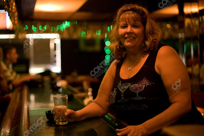 "The end of the Space Shuttle program. Debbie ""Doo"" Rosa bartender at the bar ""Kennedy's"" near the Kennedy Space Center, Cape Canaveral, Florida, April 30, 2010"