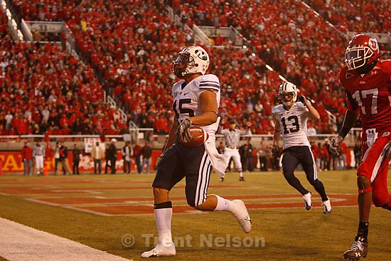 Salt Lake City - Utah vs. BYU college football Saturday, November 22, 2008 at Rice-Eccles Stadium. BYU RB Harvey Unga (45) runs a touchdown. Utah defensive back Robert Johnson (17) BYU WR Luke Ashworth (13)