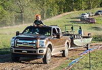 Trucks and boats depart during the kickoff of the U.S. Open Bowfishing Championship, Saturday, May 3, 2014. <br /> <br /> Photo by Matt Nager