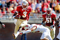 TALLAHASSEE, FL 10/29/11-FSU-NCST102911 CH-Florida State quarterback EJ Manuel hurdles N.C. State's Brandon Bishop near the end of a 21-yard run during second half action Saturday at Doak Campbell Stadium in Tallahassee. The Seminoles shut out the Wolfpack 34-0..COLIN HACKLEY PHOTO