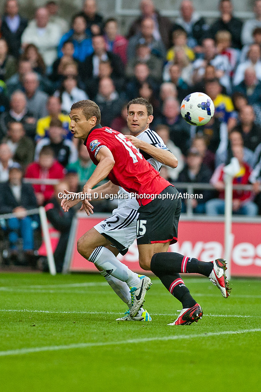 Saturday 17 August 2013<br /> <br /> Pictured: Angel Rangel of Swansea and Nemanja Vidic (captain) of Manchester United<br /> <br /> Re: Barclays Premier League Swansea City v Manchester United at the Liberty Stadium, Swansea, Wales