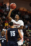 March 7, 2015; Las Vegas, NV, USA; Pepperdine Waves guard Jeremy Major (3) shoots the basketball against San Diego Toreros forward Thomas Jacobs (15) during the first half of the WCC Basketball Championships at Orleans Arena.