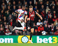 Wilfried Zaha of Crystal Palace and Simon Francis of AFC Bournemouth get airborne during AFC Bournemouth vs Crystal Palace, Premier League Football at the Vitality Stadium on 1st October 2018