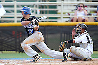 Brevard County CC Michael DeLucia #13 at bat in front of catcher Jacob Bogaards #23 during a game against Miami-Dade at Miami-Dade Community College on March 26, 2011 in Miami, Florida.  Photo By Mike Janes/Four Seam Images