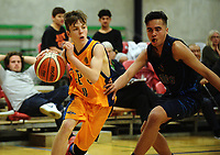 Action from the 2017 AA Boys' Secondary Schools Basketball Premiership National Championship match between St Peter's College Auckland (gold) and Mt Albert Grammar School (navy) at the B&M Centre in Palmerston North, New Zealand on Monday, 2 October 2017. Photo: Dave Lintott / lintottphoto.co.nz