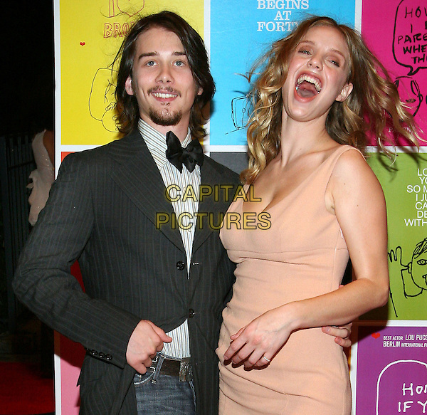 "LOU PUCCI & KELLI GARNER.The NY Premiere of ""Thumbsucker"", Bryant Park Grill, NYC. .September 14th, 2005.Photo Credit Jackson Lee/Admedia/Capital Pictures.Ref: JL/ADM/CAP.half length bow tie goatee facial hair laughing mouth open.www.capitalpictures.com.sales@capitalpictures.com.© Capital Pictures."