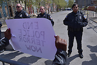 Baltimore, MD - April 25, 2015: A woman holds a sign directed at Baltimore City police as hundreds of protestors gathered near the Baltimore Police Department's Western District Headquarters April 25, 2015 to demand police accountability in the death of Freddie Gray and protest police brutality. Gray died of a broken spine while in police custody.  (Photo by Don Baxter/Media Images International)
