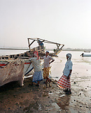ERITREA, Massawa, fishermen work on their boat by the edge of the Red Sea