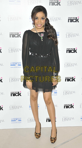"Dionne Bromfield.The ""A Night With Nick"" charity event in aid of The Stroke Association, Swarovski CRYSTALLIZED, Gt. Marlborough St., London, England..December 6th, 2011.full length black sheer dress necklace silver brown leopard print shoes .CAP/CAN.©Can Nguyen/Capital Pictures."