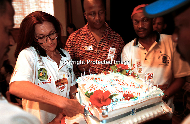 Gail Johnson cutting the birthday cake for Nkosi Johnson, with workers at Nkosis Heaven, the home for mothers and babies with HIV-Aids in Johannesburg, South Africa.Photo: Per-Anders Pettersson