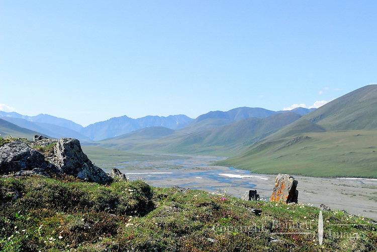 A rocky outcrop in Caribou Pass frames the Kongakut River, in Alaska's Arctic National Wildlife Refuge.