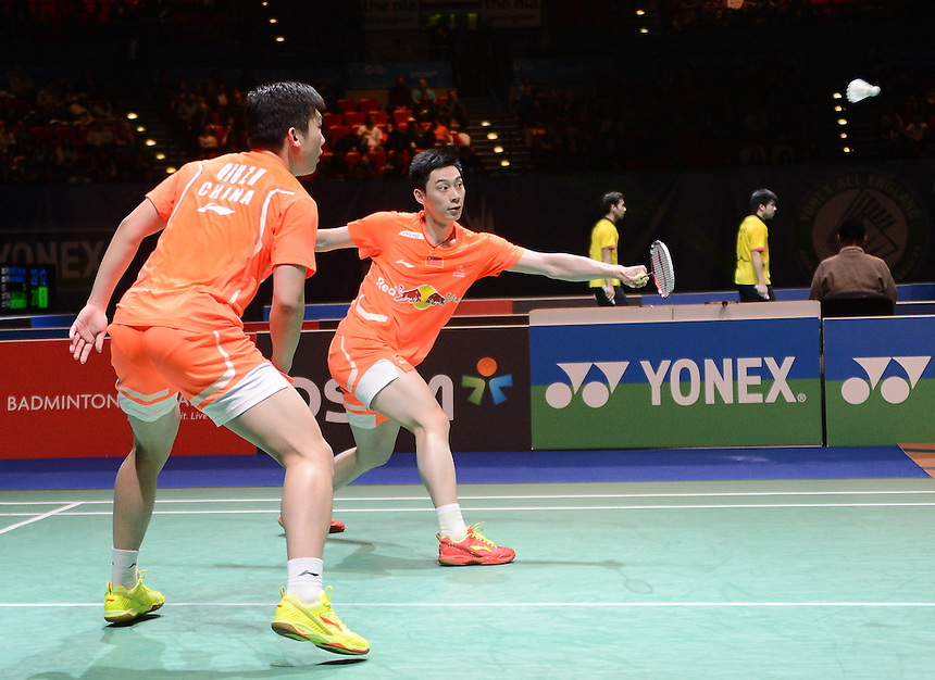 Xiaolong LIU [CHN] and Zihan QIU [CHN] in action today during their victory over Mohammad AHSAN [8] [INA] and Hendra Setiawan [INA] in their Men's Doubles Semi final match. Xiaolong LIU [CHN] and Zihan QIU [CHN] bt Mohammad AHSAN [8] [INA] and Hendra Setiawan [INA]  21-12 13-21 21-17..BWF -  2013 Yonex All England Badminton Championships Super Series Premier - The National Indoor Arena - Birmingham - England - Saturday 09th March 2013..© CameraSport - 43 Linden Ave. Countesthorpe. Leicester. England. LE8 5PG - Tel: +44 (0) 116 277 4147 - admin@camerasport.com - www.camerasport.com
