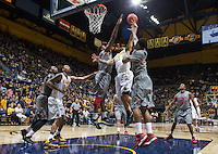 Justin Cobbs shoots for the basket during a game against Washington State at Haas Pavilion in Berkeley, California on January 5th, 2014. California defeated Washington State 76 - 55