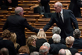 Former CIA Director John Brennan, left, shakes hands with President Donald Trump's Chief of Staff John Kelly, right, before a State Funeral for former President George H.W. Bush at the National Cathedral, Wednesday, Dec. 5, 2018,  in Washington. <br /> Credit: Andrew Harnik / Pool via CNP
