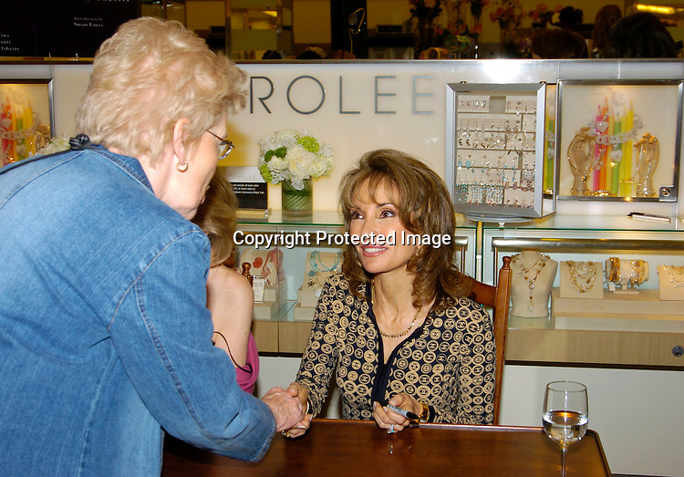 Susan Lucci and a fan ..at Bloomindales to sign Tina's new book, What Jackie Taught Us: Lessons from the Remarkabale Life of Jacqueline Kennedy Onassis. Susan Lucci signed photos of herself and the book, Jewelry designer Carolee ..donated proceeds from the sale of her jewelry to ..Little Flower Children's Services of New York.This took place on May 6, 2004..Photo by Robin Platzer, Twin Images