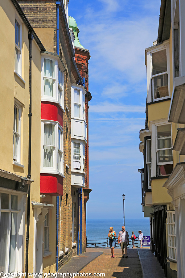 Sea view past historic houses in street, Cromer, Norfolk, England, UK