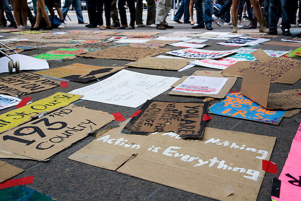 Signs are placed along the ground as protesters continue to gather in Liberty Square in lower Manhattan, New York on 30 September 2011, day 13 of Occupy Wall Street, a resistance movement targeting corporate greed and corruption.