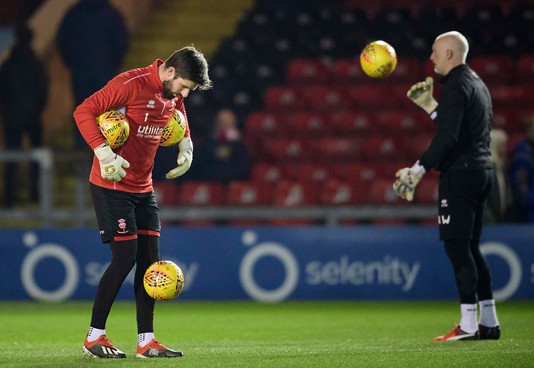 Lincoln City's Josh Vickers during the pre-match warm-up<br /> <br /> Photographer Chris Vaughan/CameraSport<br /> <br /> The EFL Sky Bet League Two - Lincoln City v Exeter City - Tuesday 26th February 2019 - Sincil Bank - Lincoln<br /> <br /> World Copyright © 2019 CameraSport. All rights reserved. 43 Linden Ave. Countesthorpe. Leicester. England. LE8 5PG - Tel: +44 (0) 116 277 4147 - admin@camerasport.com - www.camerasport.com