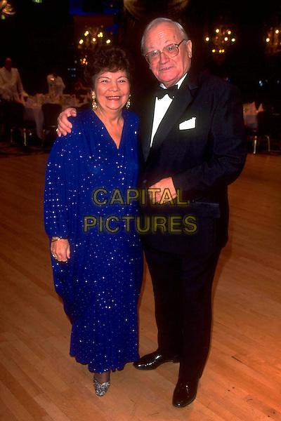 GUEST & HARRY SECOMBE.Ref: 3378.pre 2001.full length black tuxedo blue dress.CAP/IJ.©Ian Jennings/Capital Pictures.