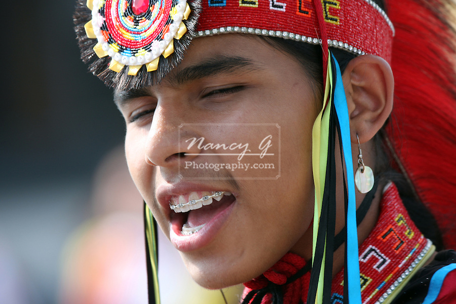 A male Native American Indian teenage dancer with braces at a Pow Wow at the Milwaukee Lakefront Indian Summer Festival, Wisconsin