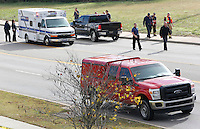 NWA Democrat-Gazette/DAVID GOTTSCHALK  A black truck that was struck by a small plane sits on Martin Luther King Boulevard as emergency responders secure the scene of a small airplane crash Tuesday, November 3, 2015, on Martin Luther King Boulevard in Fayetteville. Bill Simon, 56, Cliff Slincard, 59, and Maurice Willis, 47, were on the plane that deployed an emergency parachute attached to plane after an attempt at making an emergency landing at Drake Field in Fayetteville. The plane took off from Bentonville airport. All three men were transported to area hospitals with non life threatening injuries.