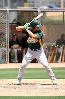 Ryan Ortiz #7 of the Oakland Athletics plays in an extended spring training game against the Chicago Cubs at the Athletics minor league complex on May 18, 2011  in Phoenix, Arizona. .Photo by:  Bill Mitchell/Four Seam Images.