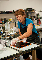 Occidental College AHVA Professor Linda Lyke works on a special piece for the innauguration of President Jonathan Veitch. August 24, 2009. (Photo by Marc Campos, Occidental College Photographer)