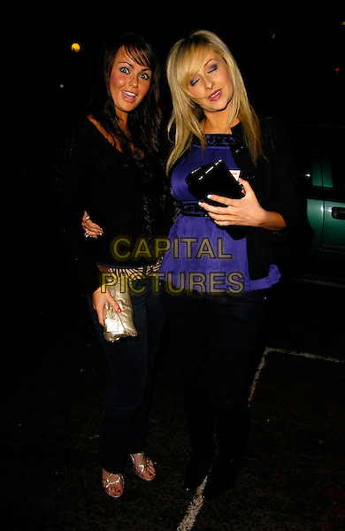 JENNIFER METCALFE & GEMMA MERNA.The Home Run Baseball themed party, Embassy Club, London, UK..November 12th, 2006.Ref: CAN.full length jeans denim black top blue gold clutch purse jacket eyes closed.www.capitalpictures.com.sales@capitalpictures.com.©Can Nguyen/Capital Pictures