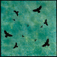 Mixed media encaustic photo transfer painting of crows in teal green sky.