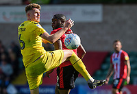 Fleetwood Town's Harry Souttar vies for possession with Lincoln City's John Akinde<br /> <br /> Photographer Chris Vaughan/CameraSport<br /> <br /> The EFL Sky Bet League One - Lincoln City v Fleetwood Town - Saturday 31st August 2019 - Sincil Bank - Lincoln<br /> <br /> World Copyright © 2019 CameraSport. All rights reserved. 43 Linden Ave. Countesthorpe. Leicester. England. LE8 5PG - Tel: +44 (0) 116 277 4147 - admin@camerasport.com - www.camerasport.com