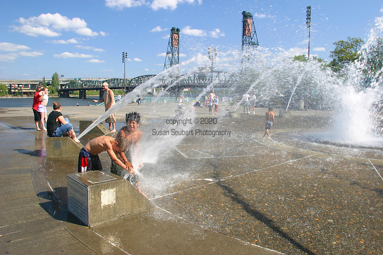 Children play in the Salmon Street Fountain in downtown Portland, Oregon