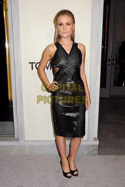 Anna Paquin.Tom Ford Cocktail Party held at the Tom Ford Store, Beverly Hills, California, USA..February 21st, 2013.full length black shiny dress cut out open toe shoes hand on hip.CAP/ADM/BP.©Byron Purvis/AdMedia/Capital Pictures.