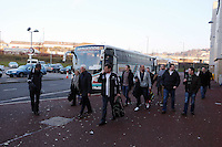 Pictured: Swansea supporters get on some of the dozens of coaches used to transport them to London from the Liberty stadium, ahead of today's clash. Sunday 24 February 2013<br /> Re: Capital One Cup final, Swansea v Bradford at the Wembley Stadium in London.