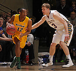SIOUX FALLS, SD - MARCH 12:  Lawrence Alexander #12 of North Dakota State drives toward Nate Wolters #3 of South Dakota State during their championship game at the 2013 Summit League Tournament at the Sioux Falls Arena. (Photo by Dick Carlson/Inertia)