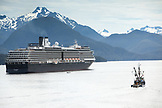 USA, Alaska, Sitka, a fishing boat passes by a cruise ship that is anchored for the night, Crescent Bay, Sitka Sound
