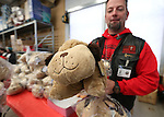Paul Kluever, with the Roughnecks motorcycle club, hands out Pillow Pets at the 10th annual Holiday with a Hero event at Walmart in Carson City, Nev., on Wednesday, Dec. 17, 2014. The event pairs 200 of Carson City's K-5th grade homeless students with a local heroes for Christmas shopping. <br />