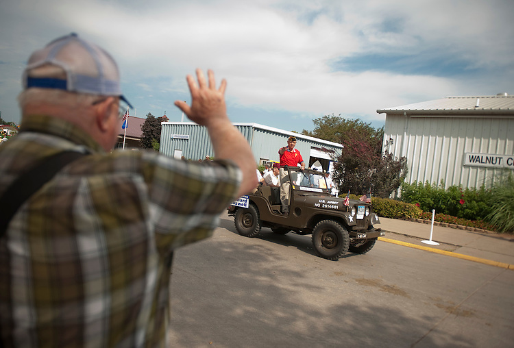 UNITED STATES - AUGUST 15:  Rep. Leonard Boswell, D-Iowa, a Vietnam veteran, waves to the crowd during the Veteran's parade at the Iowa State Fair in Des Moines, Iowa.  (Photo By Tom Williams/Roll Call)