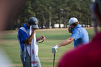 PINEHURST, NC - JUNE 15: Jordan Spieth, right, and his caddy wipe away the sweat before teeing off on 13. Scenes from the U.S. Open Championship at Pinehurst, North Carolina on Sunday, June 15, 2014. (Photo by Landon Nordeman)