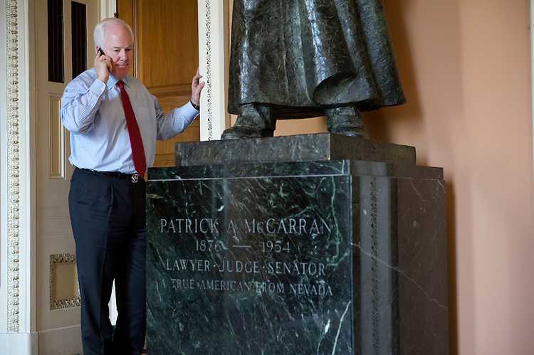 UNITED STATES - AUGUST 1: Sen. John Cornyn, R-Texas, speaks on the phone outside of the Senate in the U.S. Capitol. (Photo By Chris Maddaloni/CQ Roll Call)