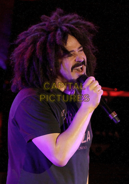 Adam Duritz of Counting Crows.Hit rockers Counting Crows made a stop on their tour at the Tabernacle in downtown Atlanta, GA., where they performed for a sold-out crowd of fans, Atlanta, GA, USA, May 4th, 2012..music live gig half length vinny pizza t-shirt black microphone singing goatee facial hair beard .CAP/ADM/DH.©Dan Harr/AdMedia/Capital Pictures.