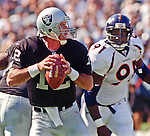 Oakland Raiders vs. Denver Broncos at Oakland Alameda County Coliseum Sunday, October 10, 1999.  Broncos beat Raiders  16-13.  Oakland Raiders quarterback Rich Gannon (12).