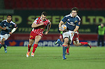 Munster wing Gerhard Van Den Heever beats Scarlets center Olly Barkley for speed to score under the posts.<br /> Celtic League<br /> Scarlets v Munster<br /> <br /> 01.03.14<br /> <br /> ©Steve Pope-SPORTINGWALES