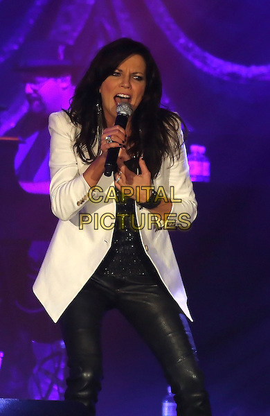 Martina McBride .performs at The Grand Event Center at Green Valley Ranch Station Hotel and Casino, Las Vegas, Nevada, USA, .3rd August 2012..country music on stage live on stage half length white jacket black leather trousers  pants microphone singing hand .CAP/ADM/MJT.© MJT/AdMedia/Capital Pictures.