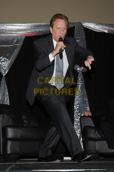 Actor James Woods attends 'A Conversation With James Woods' presented by CARSTAR Automotive Canada Inc. in support of Cystic Fibrosis Canada at Carmen's Banquet and Convention Centre, Hamilton, Ontario, Canada..November 20th, 2011.full length black suit grey gray tie white shirt microphone  hand   .CAP/ADM/BPC.©Brent Perniac/AdMedia/Capital Pictures.