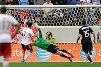 Juan Pablo Angel (9) of the New York Red Bulls beats Philadelphia Union goalkeeper Chris Seitz (1) to score the game winning goal off a penalty kick in the 67 minute. The New York Red Bulls defeated the Philadelphia Union 2-1 during a Major League Soccer (MLS) match at Red Bull Arena in Harrison, NJ, on April 24, 2010.