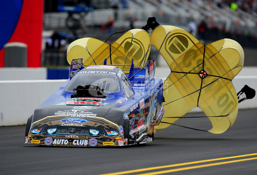 Sept. 17, 2011; Concord, NC, USA: NHRA funny car driver John Force during qualifying for the O'Reilly Auto Parts Nationals at zMax Dragway. Mandatory Credit: Mark J. Rebilas-