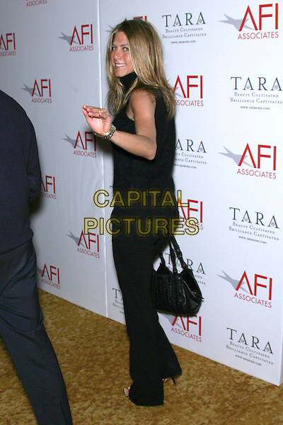 "JENNIFER ANISTON.AFI Honors Hollywood's Arquette Family With Sixth Annual ""Platinum Circle Award"" - Arrivals held at The Regent Beverly Wilshire Hotel, Beverly Hills, California , USA..May 10th, 2006.Photo: Zach Lipp/AdMedia/Capital Pictures.Ref: ZL/ADM.full length black trousers top bag purse waving looking over shoulder.www.capitalpictures.com.sales@capitalpictures.com.© Capital Pictures."